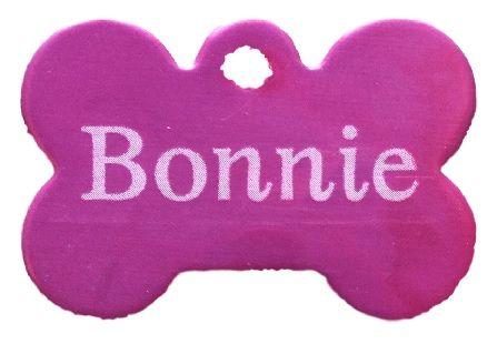 Trixie známka pro psa růžová kost s rytím